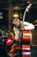 Renowned musician Keter Betts introduces a young friend to the bass.